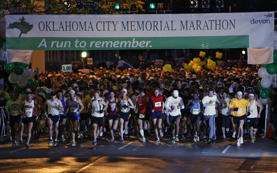 Runners take off at the start of the eighth annual Oklahoma City Memorial Marathon on Sunday , April 27, 2008, in Oklahoma City, Okla.   PHOTO BY CHRIS LANDSBERGER   ORG XMIT: KOD