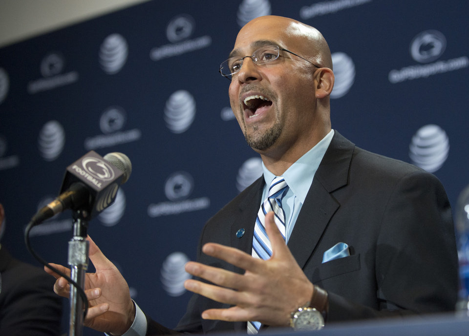 Photo - James Franklin answers questions from reporters after he was introduced as Penn State's new football coach during a news conference on Saturday Jan. 11, 2014, in State College, Pa. (AP Photo/John Beale)