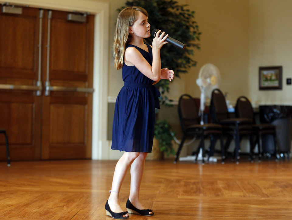 Photo -  Olivia Kay sings at the Edmond Senior Center on Thursday. Her performance included a tribute to fathers and grandfathers.Photo by Sarah Phipps, The Oklahoman   SARAH PHIPPS -  SARAH PHIPPS