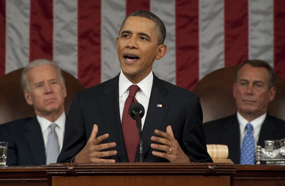 Photo - President Barack Obama delivers his State of the Union address on Capitol Hill in Washington, Tuesday, Jan. 24, 2012, as Vice President Joe Biden and House Speaker John Boehner, right, listne. (AP Photo/Saul Loeb, Pool) ORG XMIT: WX163