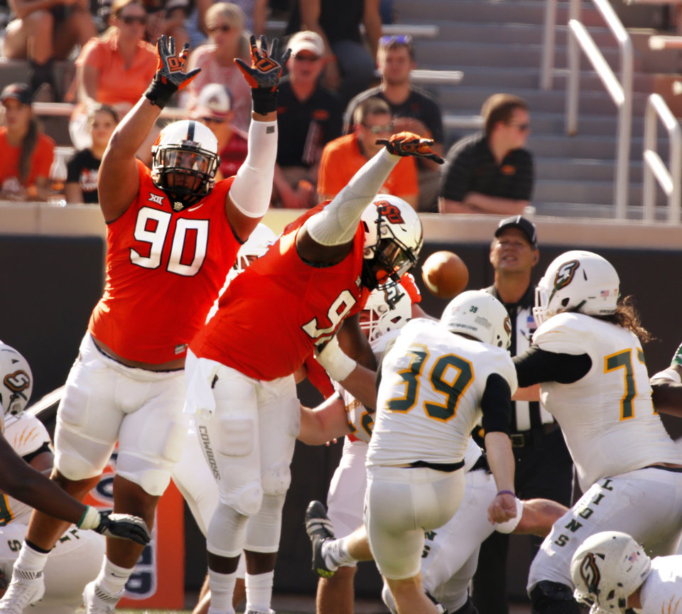 Photo - Oklahoma State's Motekiai Maile (90) and Vili Leveni (95) block a field goal attempt during the second half of a college football game between the Oklahoma State Cowboys (OSU) and the Southeastern Louisiana Lions at Boone Pickens Stadium in Stillwater, Okla., Saturday, Sept. 12, 2015. Photo by Steve Sisney, The Oklahoman