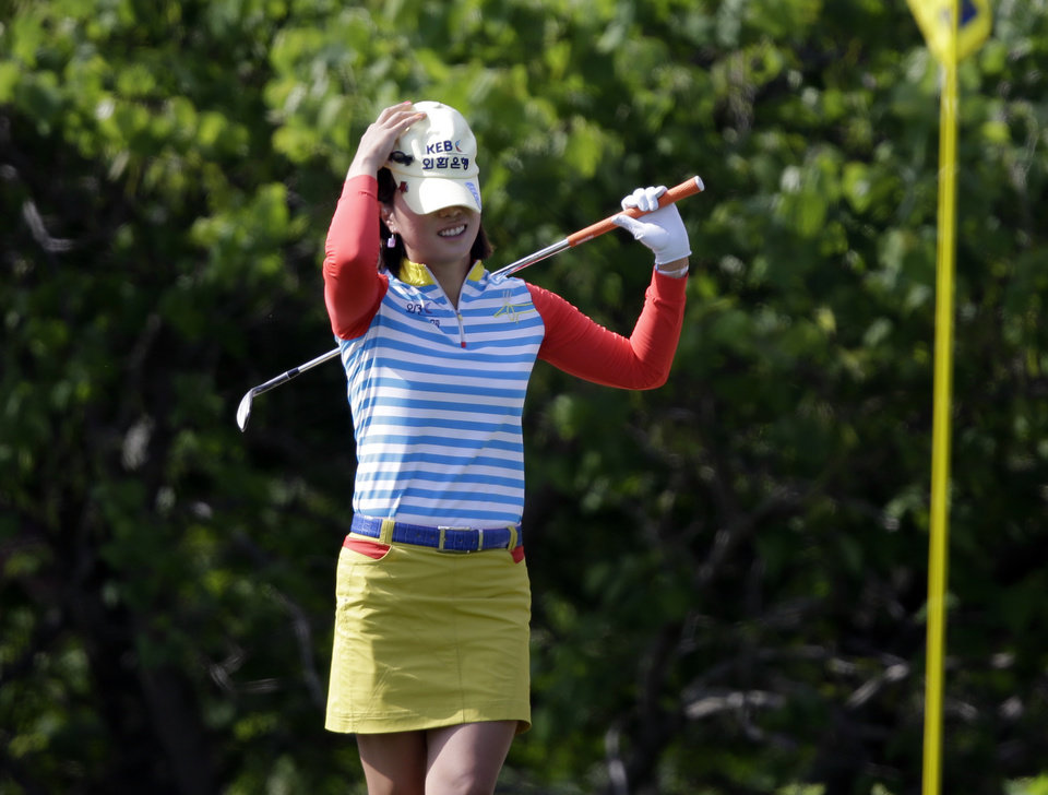 Photo - Hee Young Park, of South Korea, reacts to a missed birdie chip on the 18th green during the second round of the Kingsmill Championship golf tournament at the Kingsmill resort  in Williamsburg, Va., Friday, May 16, 2014.  (AP Photo/Steve Helber)