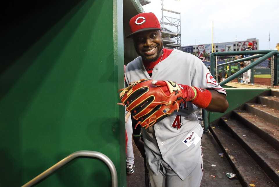 Photo - Cincinnati Reds second baseman Brandon Phillips smiles as he heads into the clubhouse after a baseball game against the Washington Nationals at Nationals Park Wednesday, May 21, 2014, in Washington. The Reds won 2-1. (AP Photo/Alex Brandon)