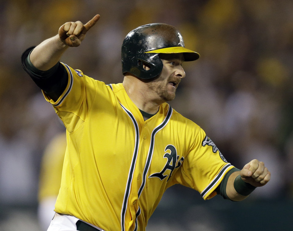 Oakland Athletics Stephen Vogt points and starts to run after making a game winning hit in the bottom of the ninth inning of Game 2 of an American League baseball Division Series against the Detroit Tigers in Oakland, Calif., Saturday, Oct. 5, 2013. (AP Photo/Ben Margot)