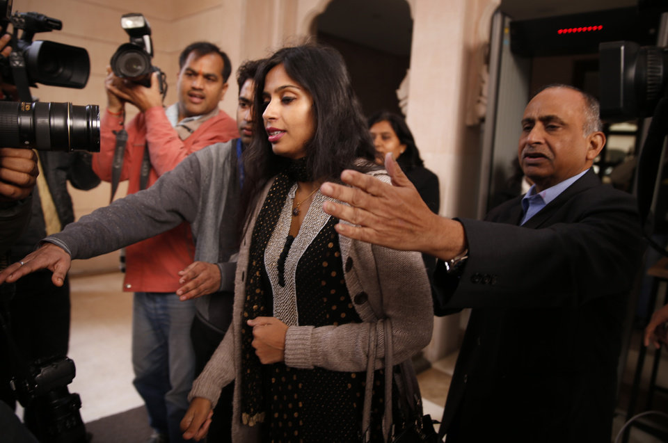 Photo - Devyani Khobragade leaves Maharastra Sadan state house in New Delhi, India, Saturday, Jan. 11, 2014. Khobragade, 39, is accused of exploiting her Indian-born housekeeper and nanny, allegedly having her work more than 100 hours a week for low pay and lying about it on a visa form. Khobragade has maintained her innocence, and Indian officials have described her treatment as barbaric. (AP Photo/Saurabh Das)