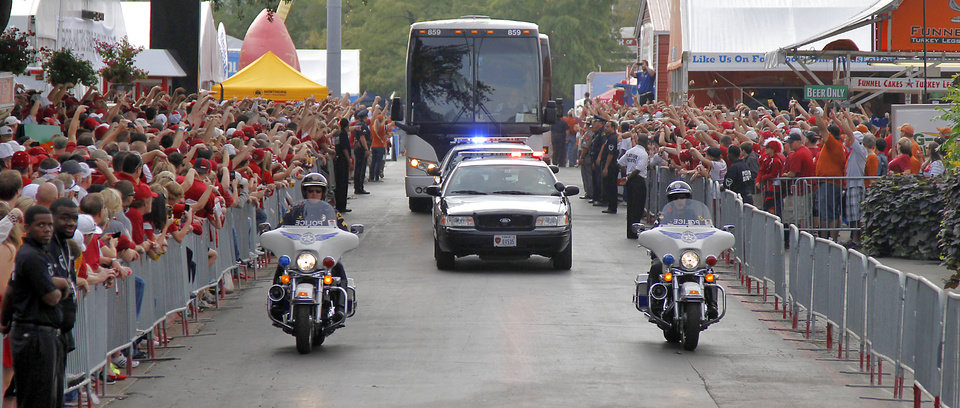 The team busses are escorted to the stadium during the Red River Rivalry college football game between the University of Oklahoma (OU) and the University of Texas (UT) at the Cotton Bowl in Dallas, Saturday, Oct. 13, 2012. Photo by Chris Landsberger, The Oklahoman