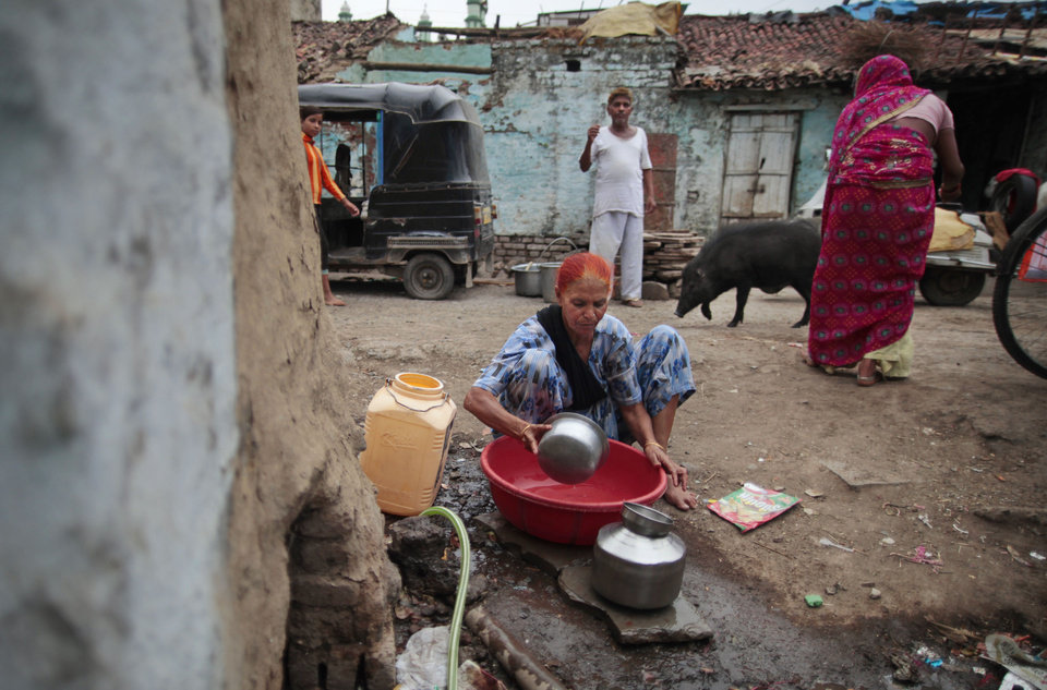 Photo -   In this May 10, 2012 photo, Fatima Munshi collects water for domestic consumption from a community faucet outside her home in Khandwa, India. Living in Australia, Saroo Brierley, 30, was reunited with his biological mother, Munshi, in February 2012, 25 years after an ill-fated train ride left him an orphan on the streets of Calcutta. (AP Photo/Saurabh Das)