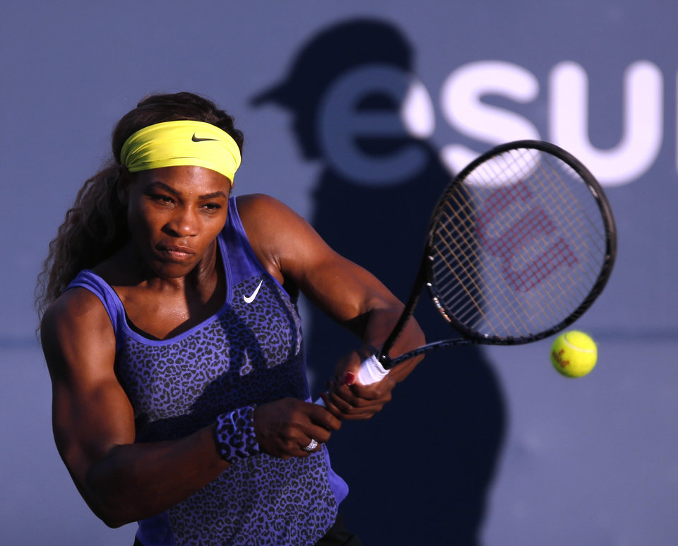 Photo - Serena Williams returns the ball during the first set of her match against Karolina Pliskova in the Bank of the West Classic, Wednesday, July 30, 2014, in Stanford, Calif. (AP Photo/Beck Diefenbach)