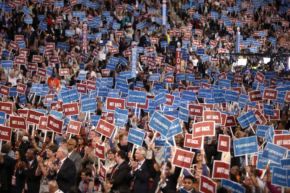 Photo - Delegates wave the signs during the Democratic National Convention in Charlotte, N.C., on Tuesday, Sept. 4, 2012. (AP Photo/Jae C. Hong)  ORG XMIT: DNC793