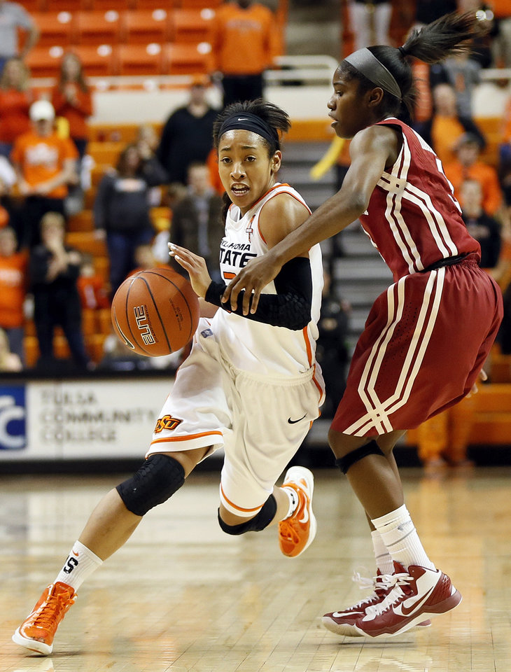Photo - Oklahoma State's Tiffany Bias (3) drives against Oklahoma's Aaryn Ellenberg (3) during the Bedlam women's college basketball game between Oklahoma State University and the University of Oklahoma at Gallagher-Iba Arena in Stillwater, Okla., Saturday, Feb. 23, 2013. OSU beat OU, 83-62. Photo by Nate Billings, The Oklahoman