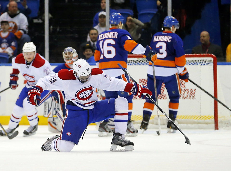 Montreal Canadiens defenseman P.K. Subban (76) celebrates scoring a goal against the New York Islanders in the second period of an NHL hockey game at the Nassau Coliseum in Uniondale, N.Y., Tuesday, March 5, 2013. (AP Photo/Paul J. Bereswill)