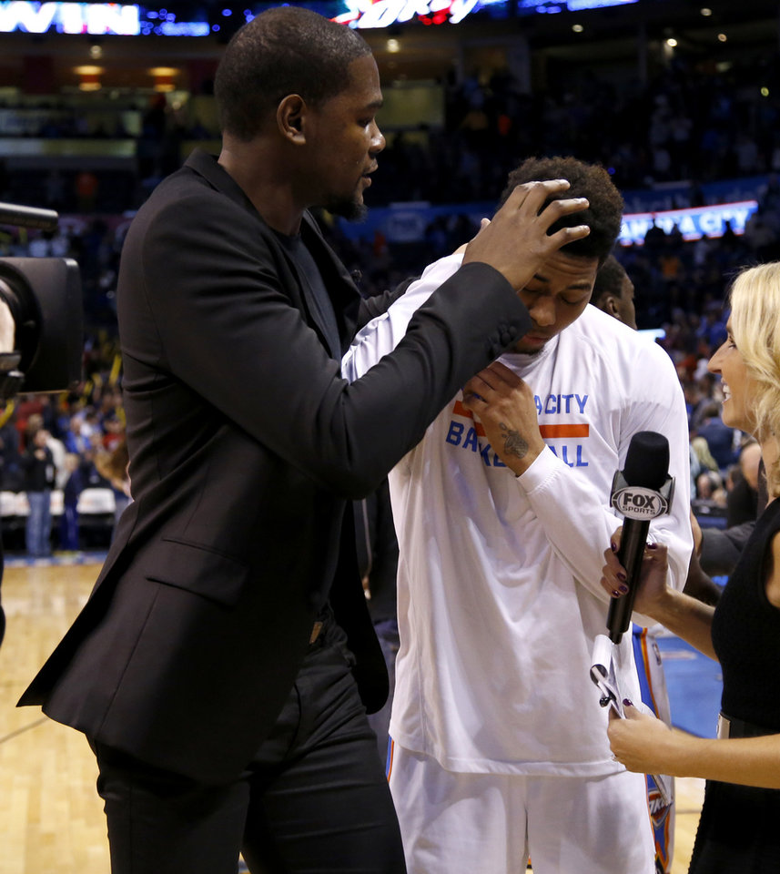 Photo - Oklahoma City's Kevin Durant jokes around with Jeremy Lamb, at right, after an NBA basketball game between the Oklahoma City Thunder and the Utah Jazz at Chesapeake Energy Arena in Oklahoma City, on Wednesday, Nov. 26, 2014. Photo by Bryan Terry, The Oklahoman