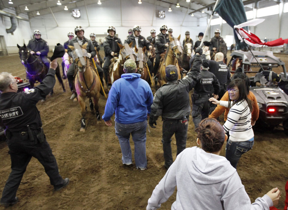 Oklahoma County deputies and their horses receive training in crowd control March 2 at State Fair Park in Oklahoma City. Photo By Paul Hellstern, The Oklahoman