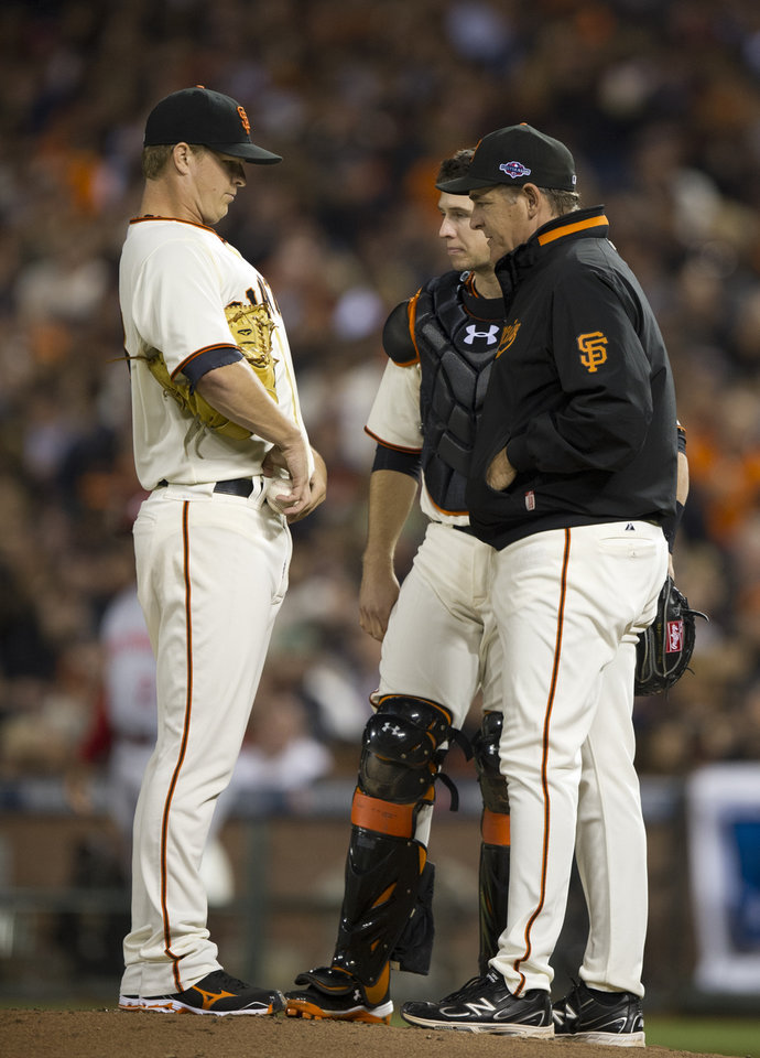 San Francisco Giants starting pitcher Matt Cain talks to pitching coach Dave Righetti after he walked his second Cincinnati Reds batter in the third inning in Game 1 of a National League baseball division series, Saturday, Oct. 6, 2012, in San Francisco. (AP Photo/The Sacramento Bee, Paul Kitagaki Jr.) MAGS OUT; TV OUT (KCRA3, KXTV10, KOVR13, KUVS19, KMAZ31, KTXL40) MANDATORY CREDIT