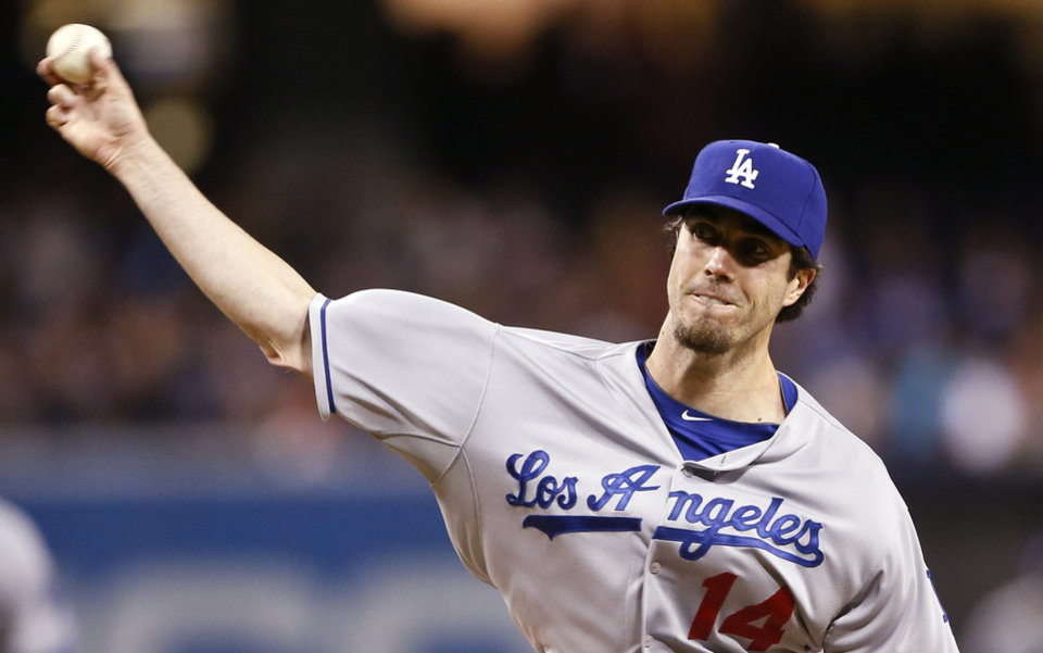 Photo - Los Angeles Dodgers starting pitcher Dan Haren works against the San Diego Padres in the first innning of a baseball game Wednesday, April 2, 2014, in San Diego.  (AP Photo/Lenny Ignelzi)