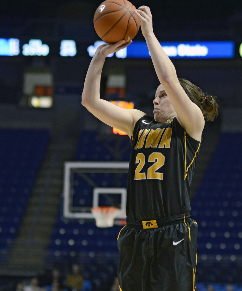 Photo - Iowa's Samantha Logic (22) looks to the basket during the second half of an NCAA college basketball game on Thursday, Feb. 6, 2014 in State College, Pa. (AP Photo/Ralph Wilson)