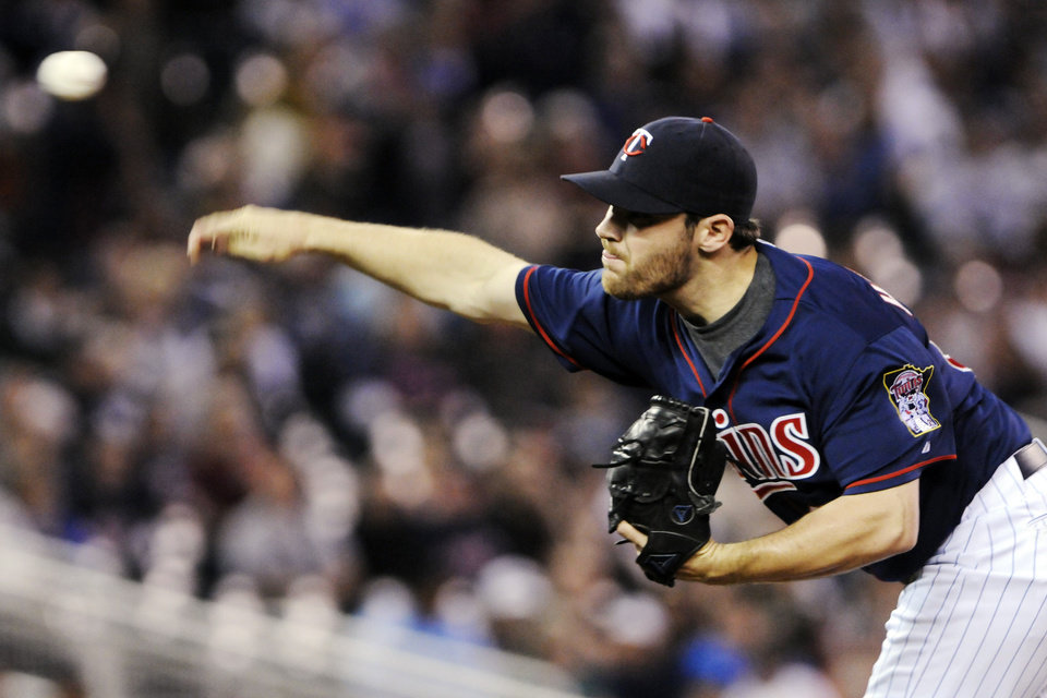 Photo -   Minnesota Twins pitcher Liam Hendriks throws against the New York Yankees in the first inning of a baseball game, Monday, Sept. 24, 2012, in Minneapolis. (AP Photo/Jim Mone)