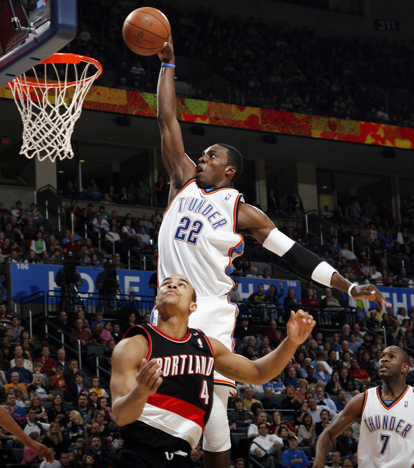 Photo - Jeff Green (22) of Oklahoma City dunks the ball over Portland's Jerryd Bayless (4) as Oklahoma City's Joe Smith (7) looks on in the third quarter during the NBA basketball game between the Oklahoma City Thunder and the Portland Trail Blazers at the Ford Center in Oklahoma City, Friday, February 6, 2009. Green's dunk broke the net, causing a  10 minute delay in the game as the net was repaired. The Thunder won, 102-93. BY NATE BILLINGS, THE OKLAHOMAN