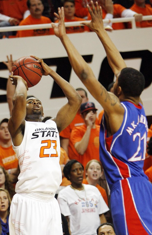 Photo - OSU's James Anderson (23) shoots over Markieff Morris (21) of KU in the first half during the men's college basketball game between the University of Kansas (KU) and Oklahoma State University (OSU) at Gallagher-Iba Arena in Stillwater, Okla., Saturday, Feb. 27, 2010. Photo by Nate Billings, The Oklahoman