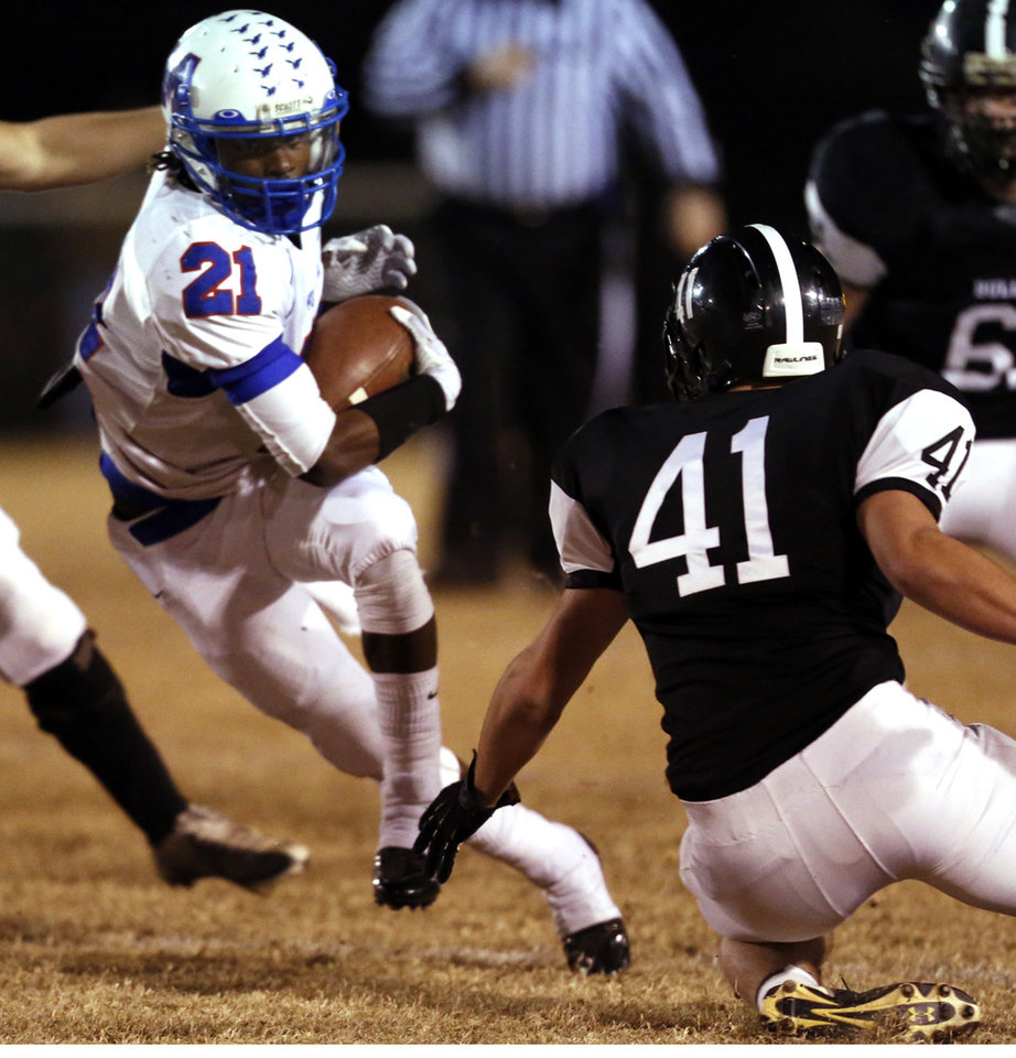 Photo - Millwood's Janari Glover runs after a catch as the Millwood Falcons play the Meeker Bulldogs in state high school football playoffs on Friday, Nov. 29, 2013, in Meeker, Okla.  Photo by Steve Sisney, The Oklahoman