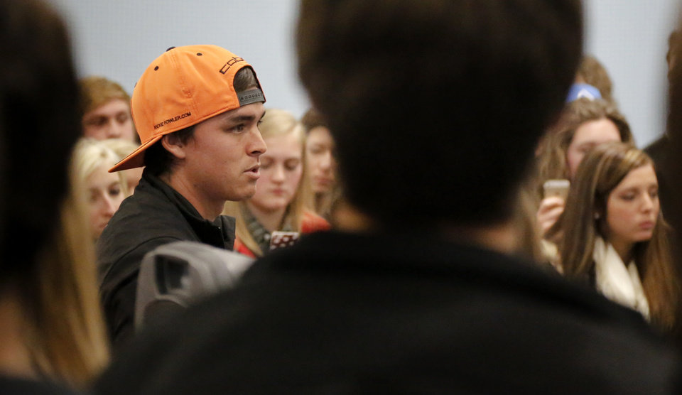 Photo - Former Oklahoma State golfer and current PGA pro Rickie Fowler gives out some golf tips while making a special appearance at Golfsmith in Oklahoma City, Okla. as a surprise to members for the three Moore school's golf teams, Monday, Jan. 6, 2014.  .Photo by Chris Landsberger, The Oklahoman
