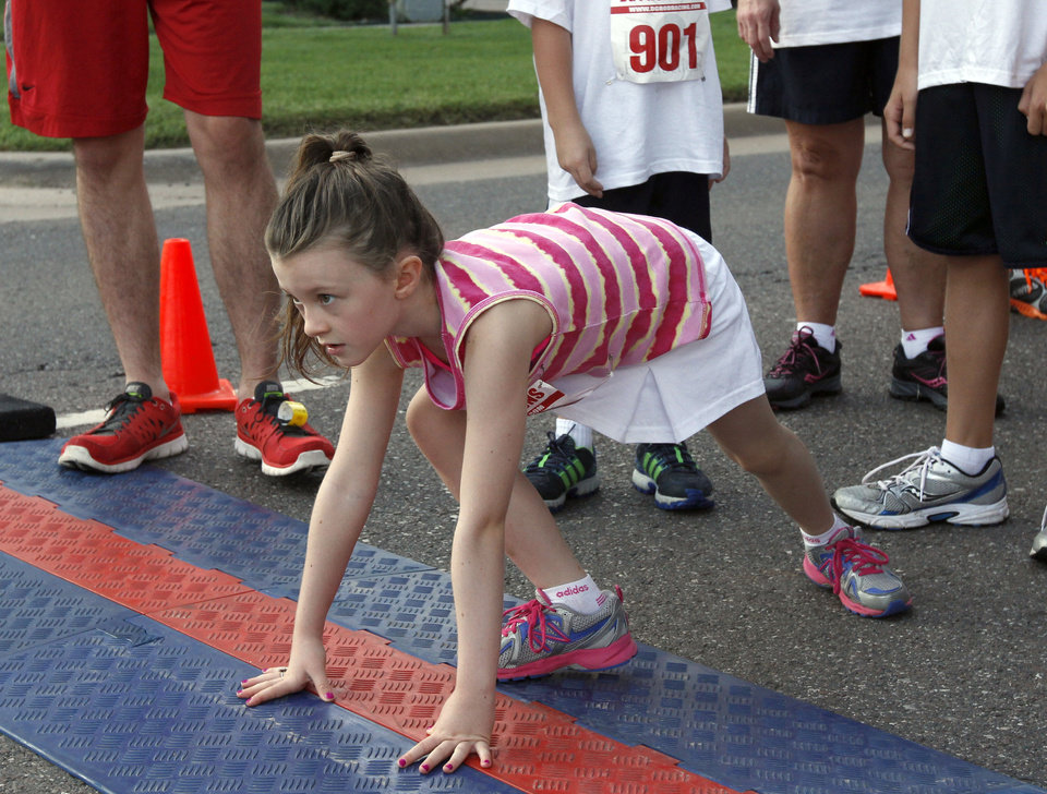 Photo -  Skye Elliott prepares to start the fun run of the 5k to Monet run last year in downtown Edmond. Photo by Paul Hellstern, The Oklahoman Archives   PAUL HELLSTERN -
