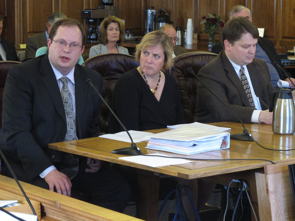 Photo - Deputy Revenue Commissioner Mike Pawlowski, left, addresses members of the House Finance Committee as the committee prepares to advance the governor's gas line bill on Friday, April 18, 2014, in Juneau, Alaska. Also shown is Revenue Commissioner Angela Rodell and Natural Resources Commissioner Joe Balash. (AP Photo/Becky Bohrer)