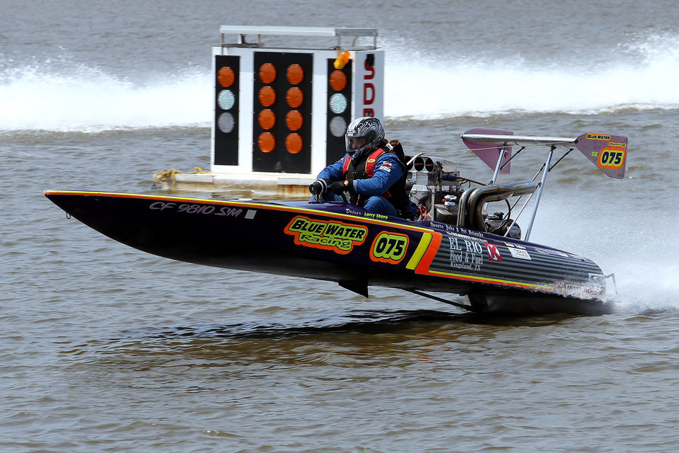 Larry Skero\'s boat comes out of the water during the Ozarka Oklahoma City Nationals Drag Boat races on the Oklahoma river Sunday, June 10th, 2012. PHOTO BY HUGH SCOTT, FOR THE OKLAHOMAN