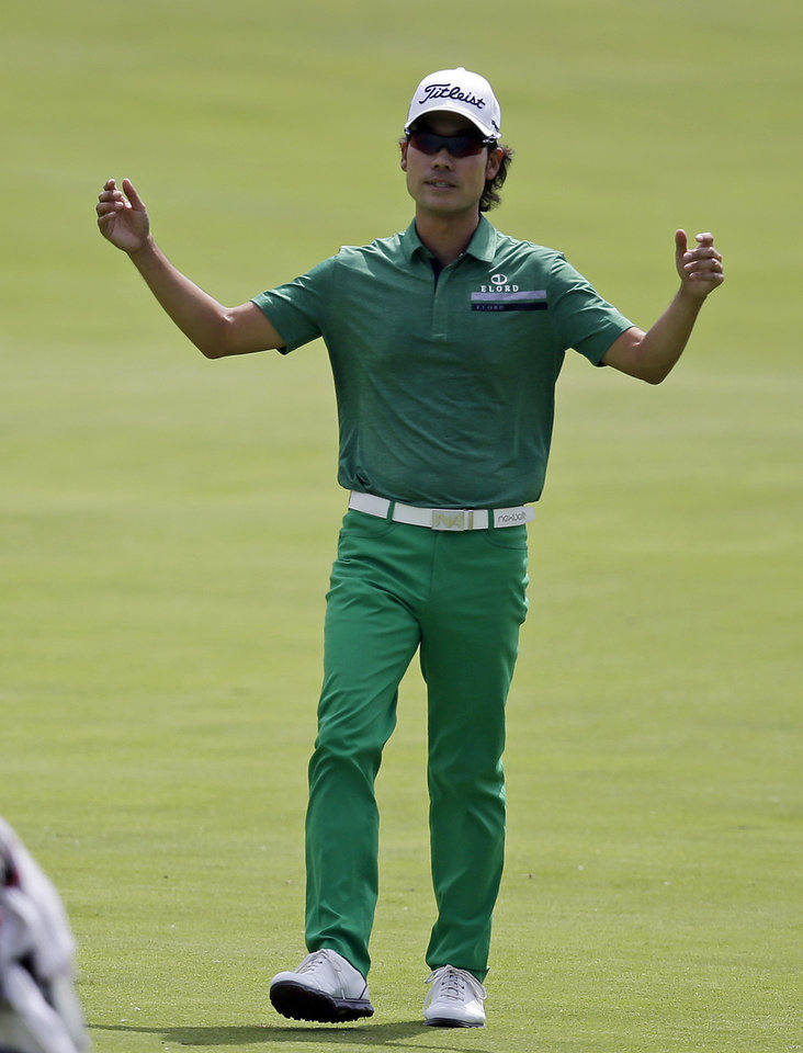 Photo - Kevin Na reacts after seeing this his drive landed in a bunker on the 17th hole during the final round of the Memorial golf tournament, Sunday, June 1, 2014, in Dublin, Ohio. (AP Photo/Darron Cummings)