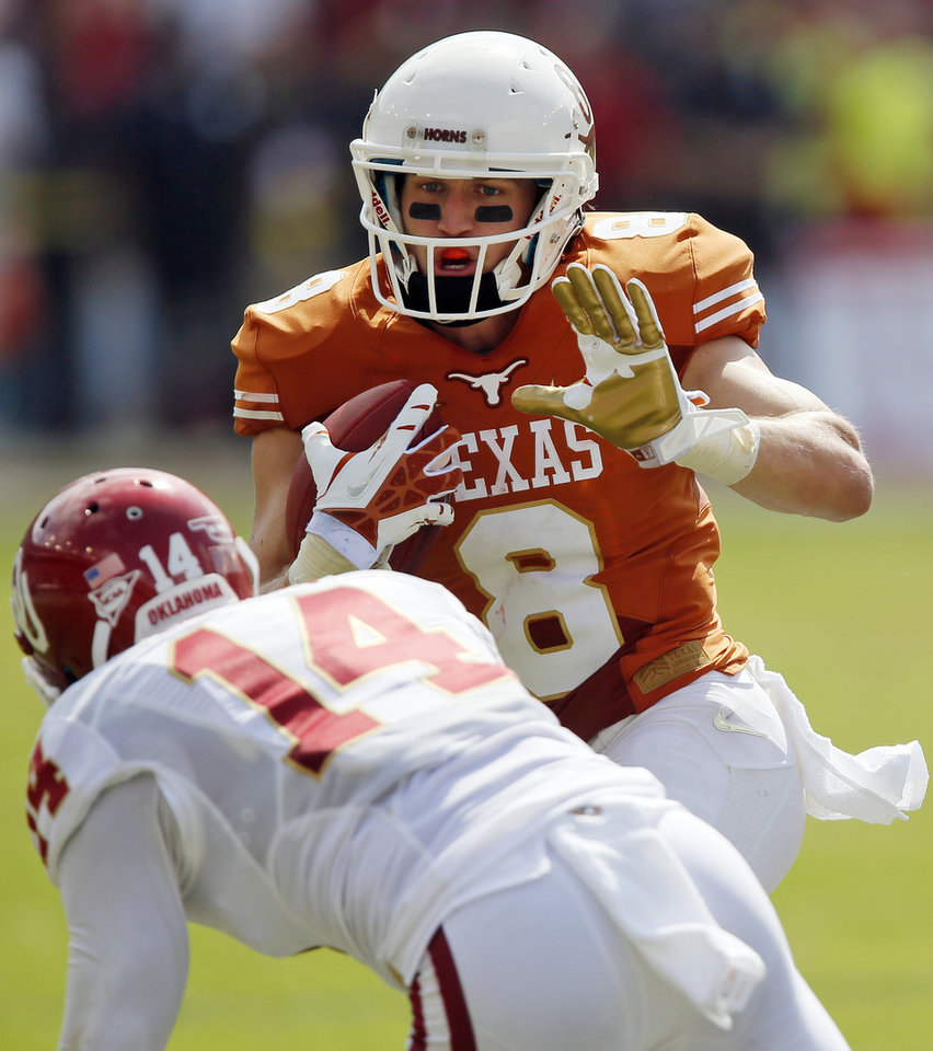 UT's Jaxon Shipley (8) tries to get past OU's Aaron Colvin (14) after a catch in the fourth quarter during the Red River Rivalry college football game between the University of Oklahoma Sooners and the University of Texas Longhorns at the Cotton Bowl Stadium in Dallas, Saturday, Oct. 12, 2013. Photo by Nate Billings, The Oklahoman