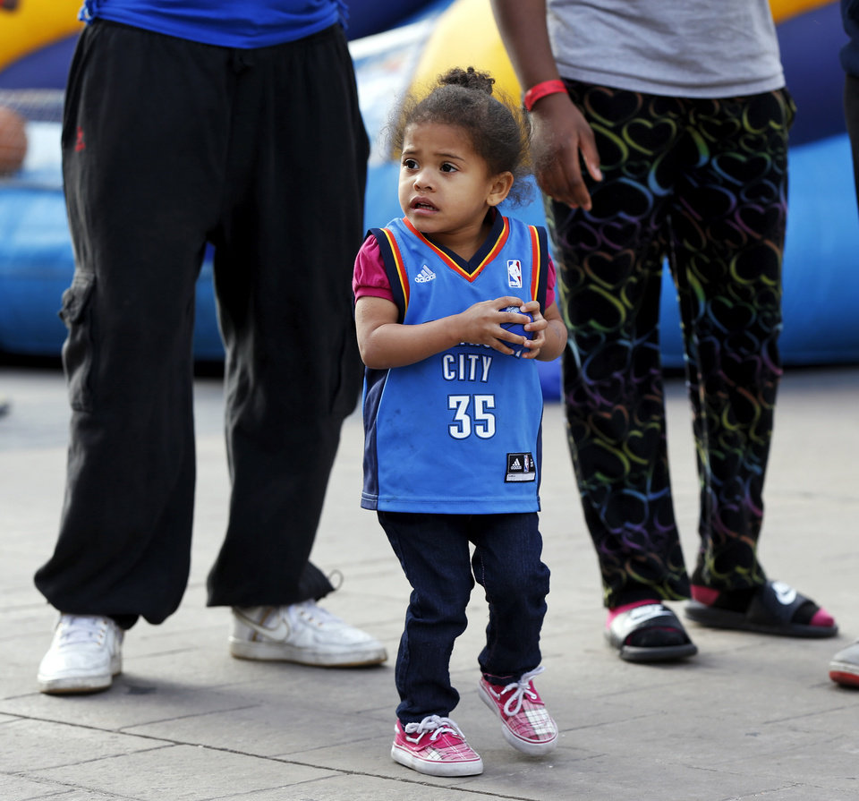 Photo - Koreona Russell, 2, of Oklahoma City, stands in Thunder Alley before Game 5 in the first round of the NBA playoffs between the Oklahoma City Thunder and the Memphis Grizzlies at Chesapeake Energy Arena in Oklahoma City, Tuesday, April 29, 2014. Photo by Nate Billings, The Oklahoman
