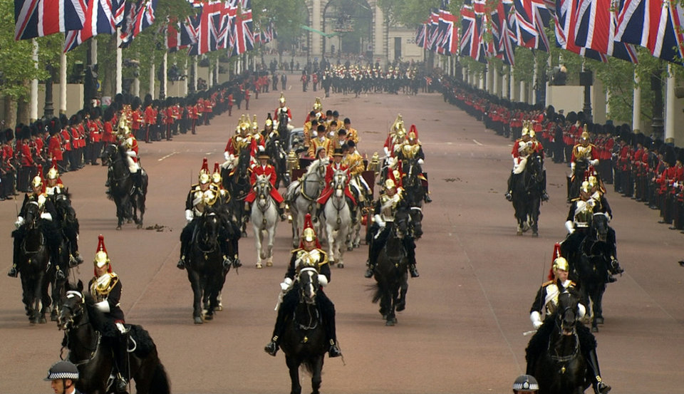 Photo - The carriage containing Britain's Prince William and his wife, Kate, the Dutchess of Cambridge, moves down the Mall, toward Buckingham Palace, druring the Royal Wedding in London on Friday, April, 29, 2011. (AP Photo/APTN) EDITORIAL USE ONLY NO ARCHIVE PHOTO TO BE USED SOLELY TO ILLUSTRATE NEWS REPORTING OR COMMENTARY ON THE FACTS OR EVENTS DEPICTED IN THIS IMAGE ORG XMIT: RWVM316