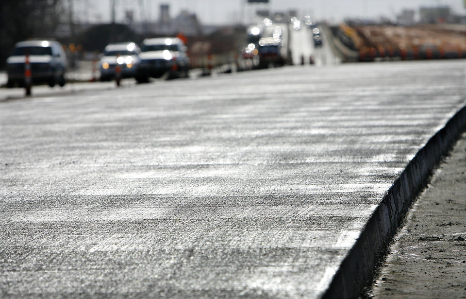 Damp convrete sparkles in sunlight as traffic passes in background. Construction progress on Broadway Extension widening and interchange project at Memorial Road, Tuesday, February 3, 2009.  BY JIM BECKEL, THE OKLAHOMAN