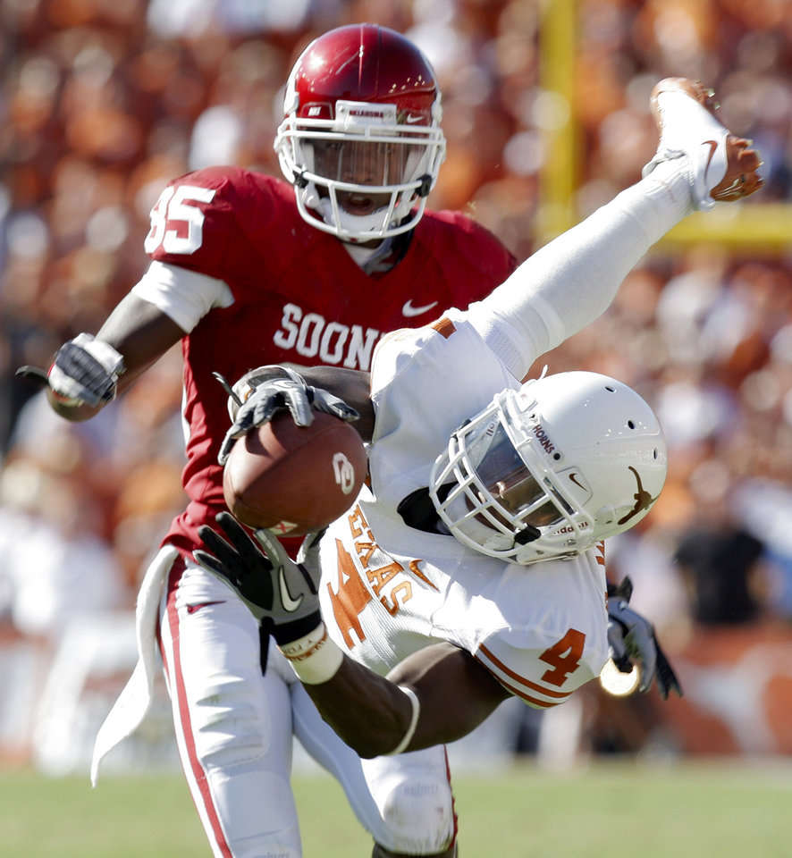 Aaron Williams (4) of Texas tries to make an interception but cannot hold on to a pass intended for OU\'s Ryan Broyles (85) in the second quarter of the Red River Rivalry college football game between the University of Oklahoma Sooners (OU) and the University of Texas Longhorns (UT) at the Cotton Bowl on Saturday, Oct. 2, 2010, in Dallas, Texas. Photo by Nate Billings, The Oklahoman