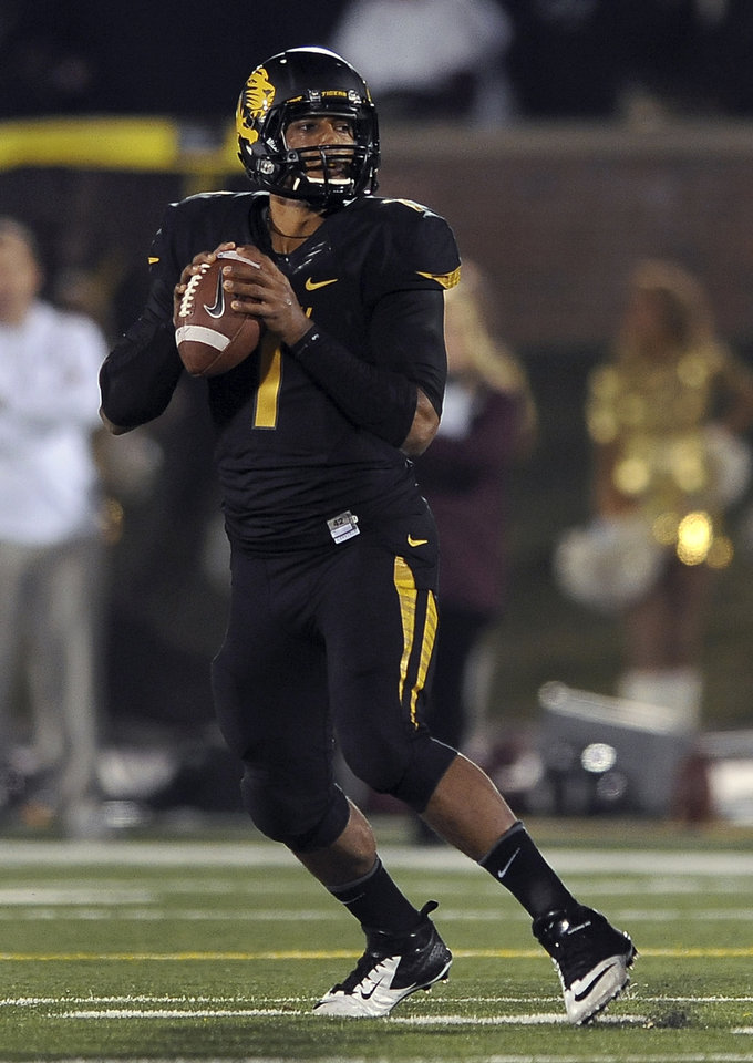 Missouri quarterback James Franklin drops back to pass during the first quarter of an NCAA college football game against Texas A&M on Saturday, Nov. 30, 2013, in Columbia, Mo. (AP Photo/L.G. Patterson)