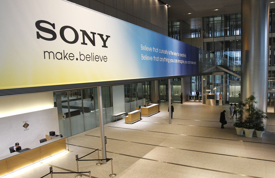 Photo -   FILE - In this April 10, 2012 file photo, the main lobby of the headquarters of Sony Corp. in Tokyo is hung with a large sign reading: Sony make.believe. Sony now has a new president - Kazuo Hirai, the former head of its game division. But shareholders are already raising doubts about his ability to revive the Japanese electronics and entertainment giant. (AP Photo/Koji Sasahara, File)