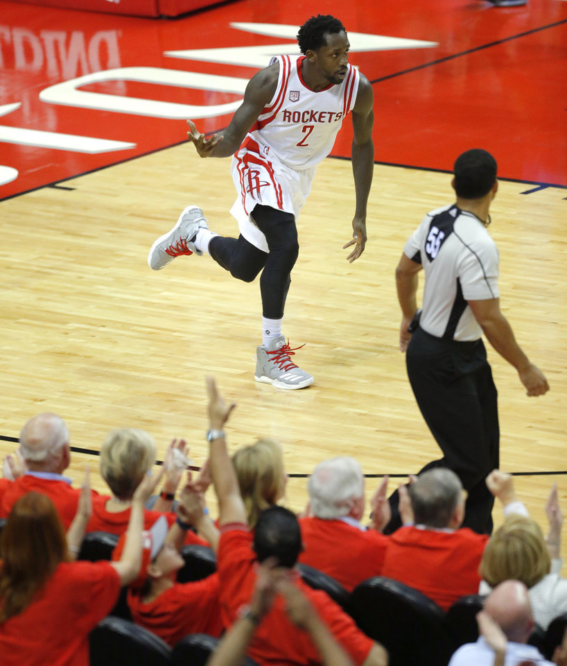 Photo - Houston's Patrick Beverley (2) celebrates after a basket during Game 5 in the first round of the NBA playoffs between the Oklahoma City Thunder and the Houston Rockets at the Toyota Center in Houston, Texas,  Tuesday, April 25, 2017.  Photo by Sarah Phipps, The Oklahoman