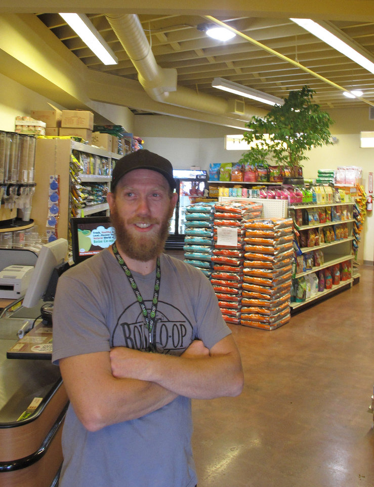 Photo -   In this photo made Monday Aug. 27, 2012, Boise Co-op pet food buyer Zach Jones poses in Boise, Idaho in the store's new space dedicated to natural pet food and supplies. Opening up a separate storefront for the fast-growing pet food segment is one of the ways the 39-year-old co-op is gearing up for increased competition from Whole Foods Market, which opens in Boise in October. (AP Photo/John Miller)