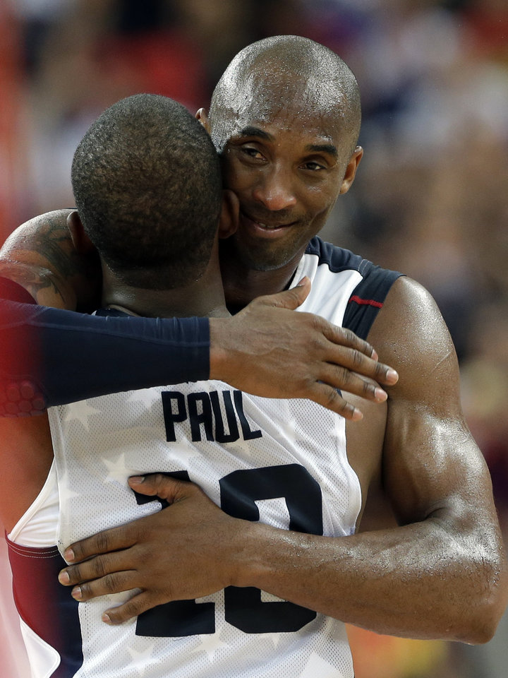 United States' Kobe Bryant and Chris Paul  celebrate after the men's gold medal basketball game at the 2012 Summer Olympics, Sunday, Aug. 12, 2012, in London. USA won 107-100. (AP Photo/Eric Gay)