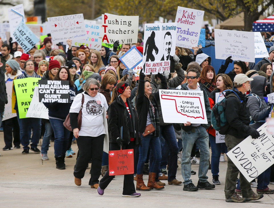 Photo - Teachers and their supporters march around the state Capitol during a rally and walkout by Oklahoma teachers, in Oklahoma City, Monday, April 2, 2018. Photo by Nate Billings, The Oklahoman