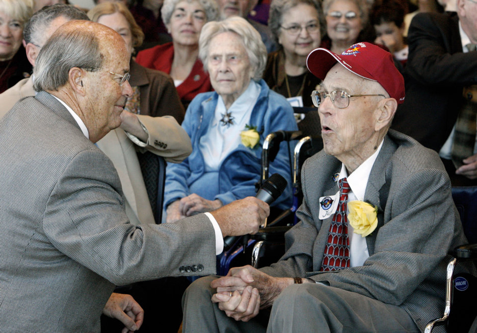 Photo - J. Blake Wade, executive director of the Oklahoma Centennial Commission, talks with Julian Stetnish, Edmond, 100, about his life while attending the Centenarian Celebration held at the Oklahoma History Center during Oklahoma Statehood Day in Oklahoma City Friday, Nov. 16, 2007. In the background center is Daisy Blackbird, 104, of Oklahoma City. By Paul B. Southerland, The Oklahoman