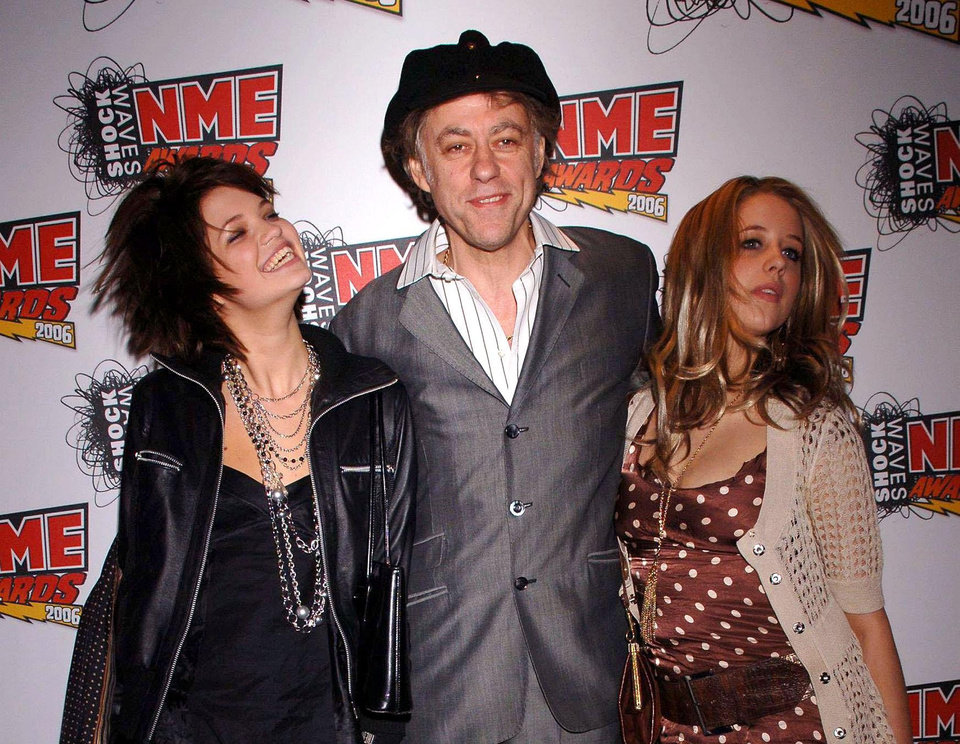 Photo - FILE - In this Feb. 23, 2006 file photo Bob Geldof is seen with his daughters Pixie, left, and Peaches at the NME Awards 2006 in London. Peaches Geldof, the model and television presenter who was concert organizer Bob Geldof's daughter, has died at age 25. Bob Geldof said in a statement Monday: