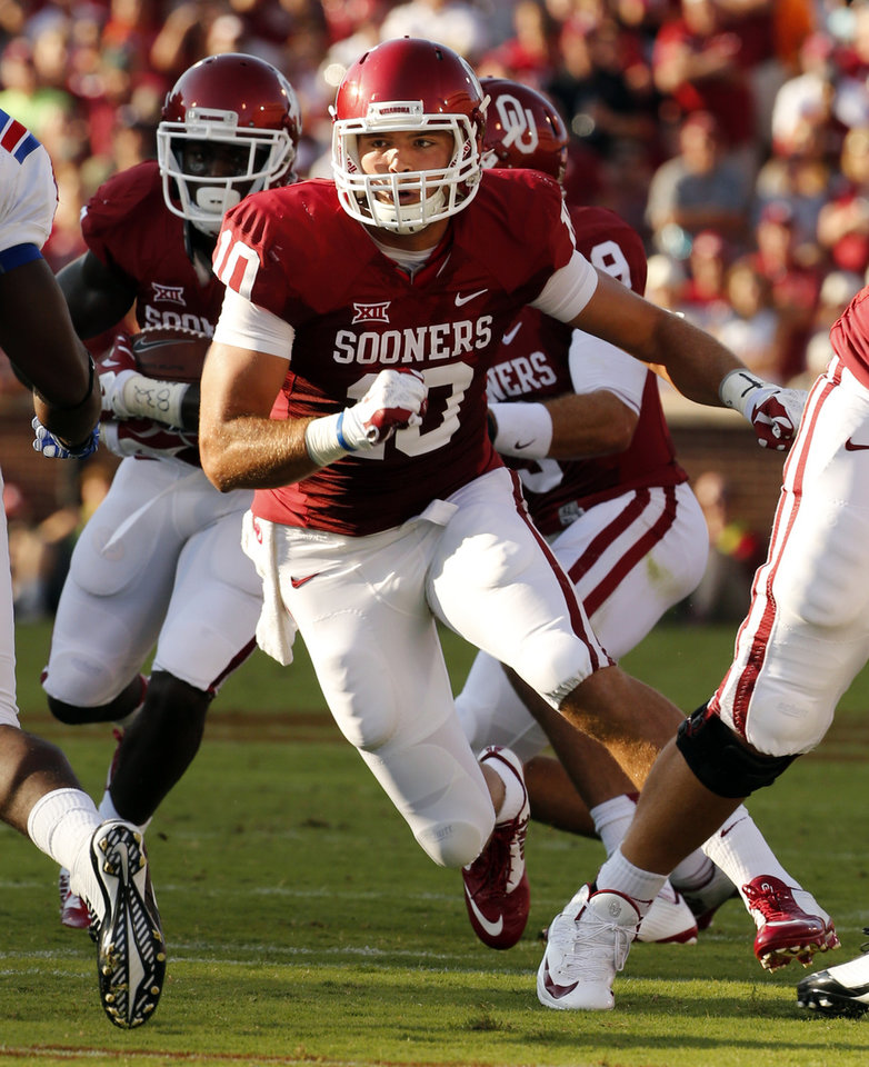 Photo - Tight end Blake Bell (10) leads the blocking on a run play during a college football game between the University of Oklahoma Sooners (OU) and the Louisiana Tech Bulldogs at Gaylord Family-Oklahoma Memorial Stadium in Norman, Okla., on Saturday, Aug. 30, 2014. Photo by Steve Sisney, The Oklahoman