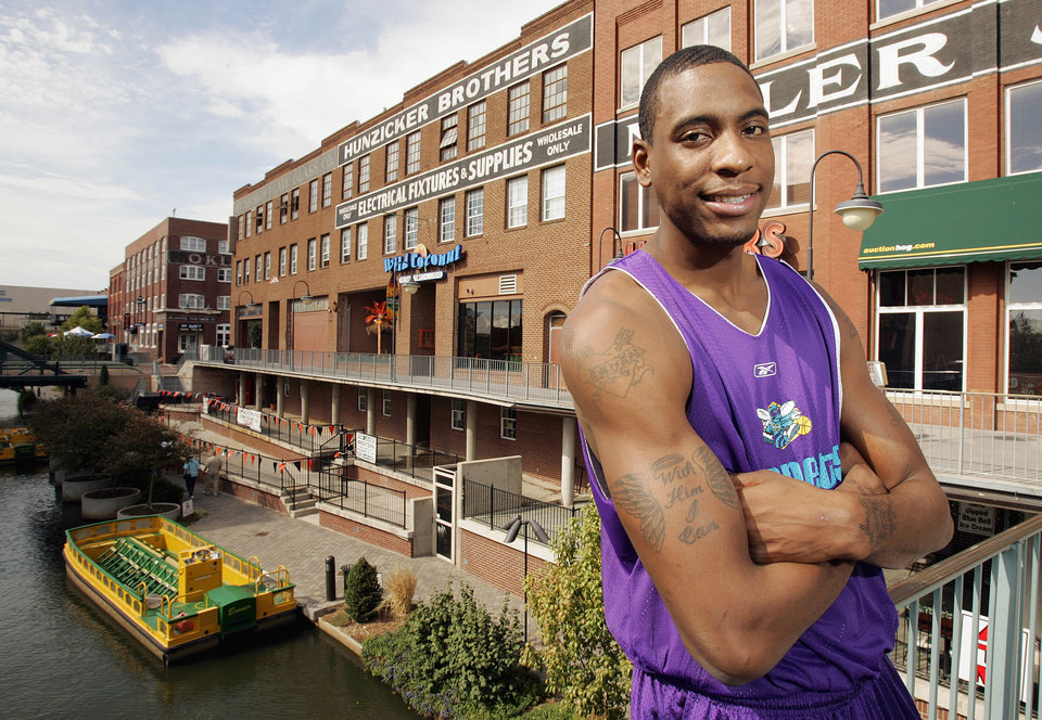 Photo - New Orleans/Oklahoma City Hornets NBA basketball player Rasual Butler poses for a photograph along the Bricktown canal in Oklahoma City, October 19, 2005. By Nate Billings/The Oklahoman