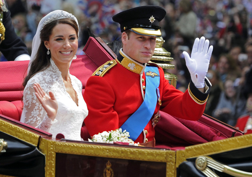 Photo - Britain's Prince William and his bride Kate, Duchess of Cambridge, leave Westminster Abbey, London, following their wedding, Friday April 29, 2011. (AP Photo/Tom Hevezi) ORG XMIT: LTH107
