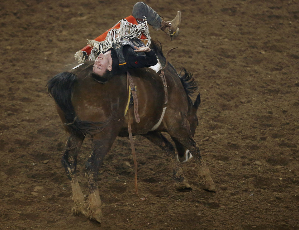 Tim O'Connell of Zwingle, Iowa, competes in bareback riding during the National Circuit Finals Rodeo at the State Fair Arena in Oklahoma City, Thursday, April 4, 2013. Photo by Bryan Terry, The Oklahoman