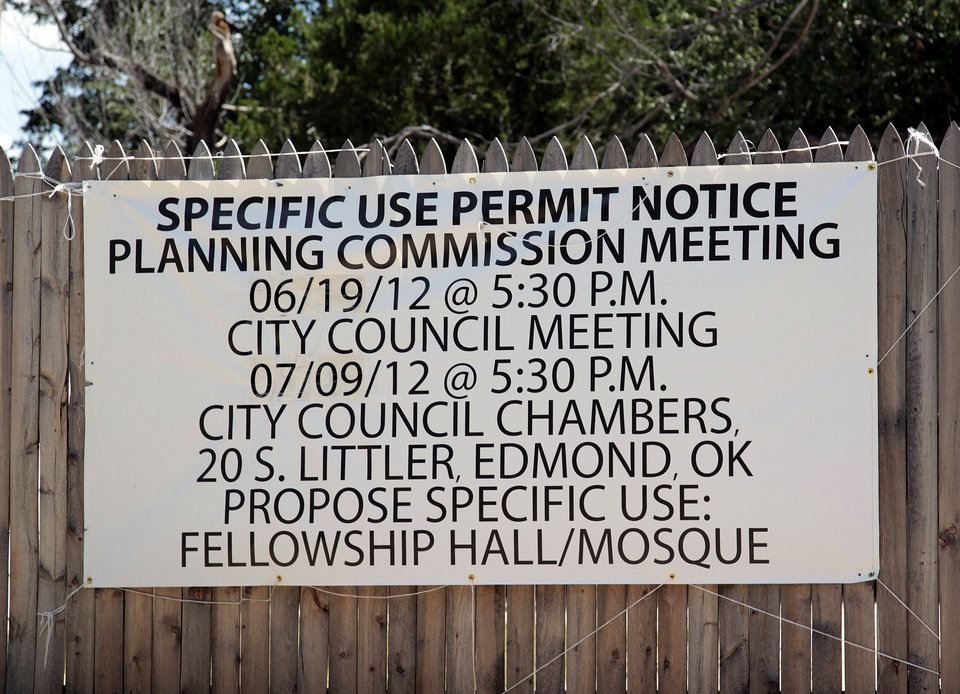 Photo - A notice of a specific use permit sign is posted on property owned near the Islamic Society of Edmond mosque at 525 N. University in Edmond. Plans are to build a new mosque and fellowship hall on the property just west of Wayne and University. PHOTO BY SARAH PHIPPS, THE OKLAHOMAN.  SARAH PHIPPS - THE OKLAHOMAN