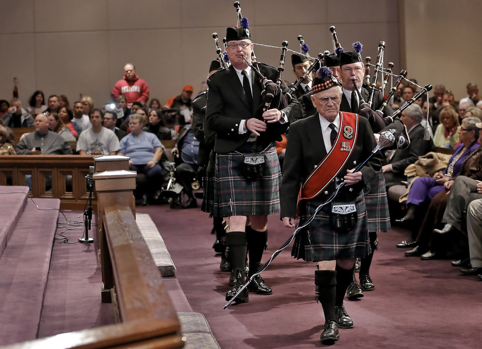 Photo - The Oklahoma Scottish Pipes and Drums members lead the procession inside the First United Methodist Church during the 18th Anniversary Remembrance Ceremony of the Oklahoma City bombing on Friday, April 19, 2013, in Oklahoma City, Okla.   Photo by Chris Landsberger, The Oklahoman