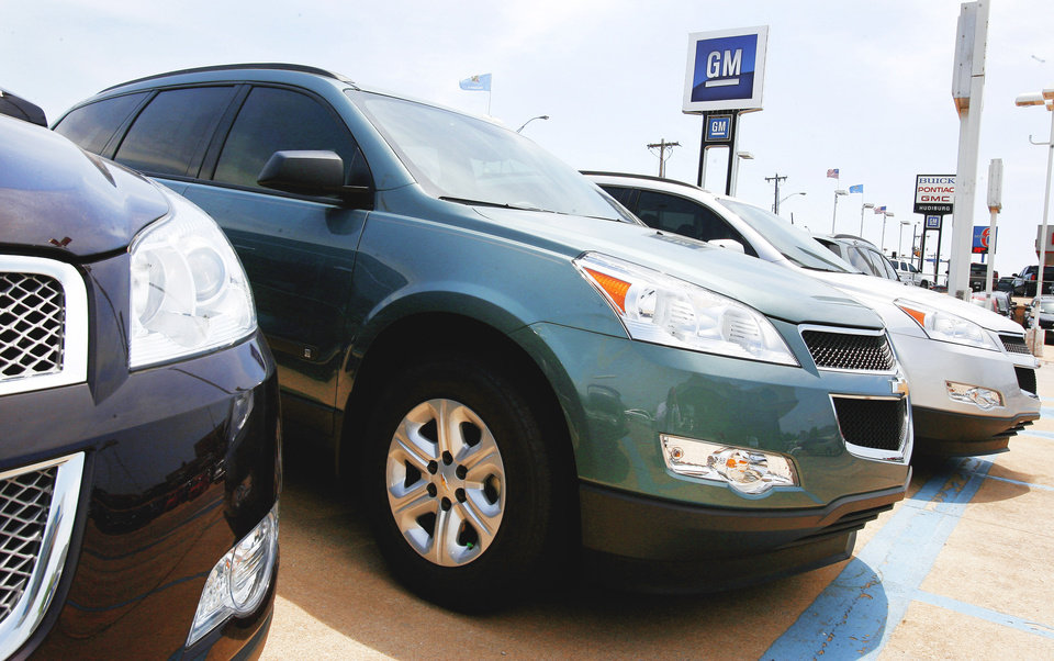 Photo - New Chevy Traverse models are displayed on the lot of Hudiburg Chevrolet in Midwest City. PHOTO BY PAUL B. SOUTHERLAND, THE OKLAHOMAN