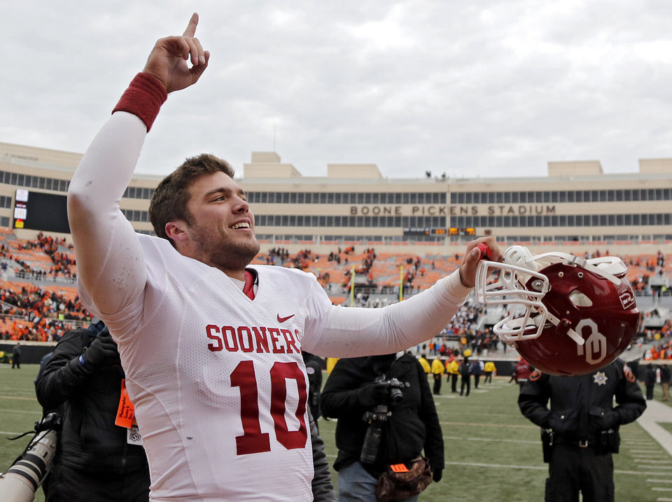 Photo - Oklahoma's Blake Bell (10) celebrates after the Bedlam college football game between the Oklahoma State University Cowboys (OSU) and the University of Oklahoma Sooners (OU) at Boone Pickens Stadium in Stillwater, Okla., Saturday, Dec. 7, 2013. Photo by Chris Landsberger, The Oklahoman